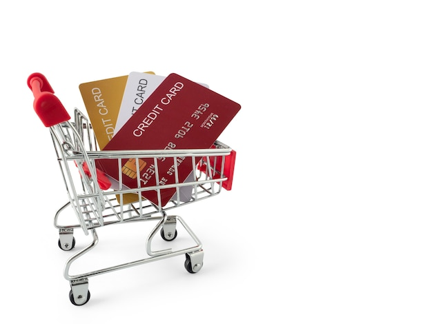 Mini shopping cart and credit card stack for present by credit card concept