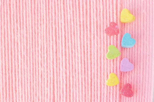 Mini sweethearts on yarn is pastel color background.