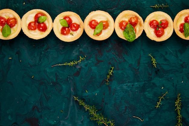 Mini tarts with cherry tomatoes