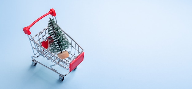 Mini trolley cart copy on blue with fir tree