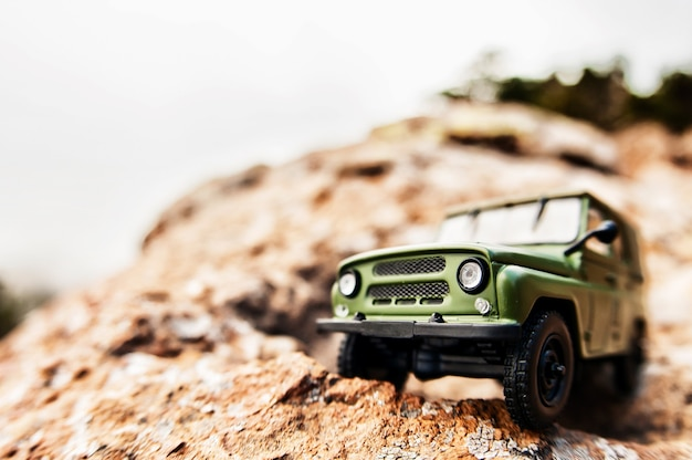 Miniature 4x4 offroad car on the edge of a cliff