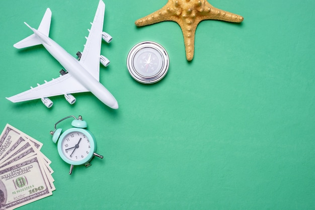 Miniature airplane and travel accessories on the green