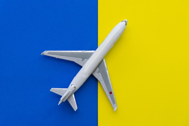 Miniature airplane travel theme. yellow background with copy space.