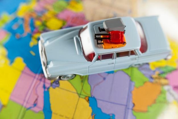 Miniature car on a map