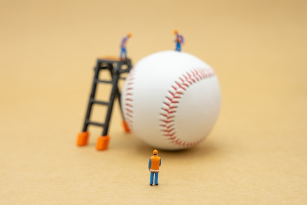 Miniature of construction worker with baseball