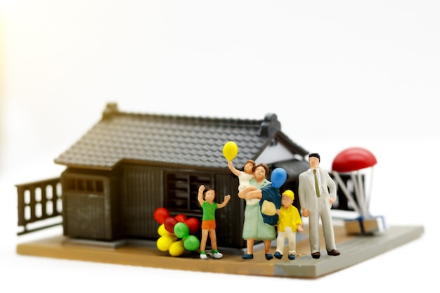 Miniature family in front of the house