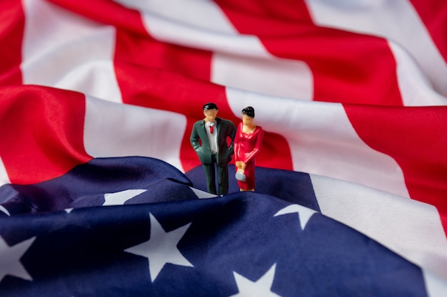 Miniature figure of a female and male politicians on usa flag