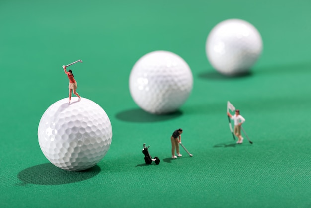 Miniature figures of golfers playing golf
