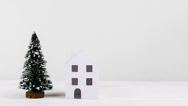 Miniature fir tree and house