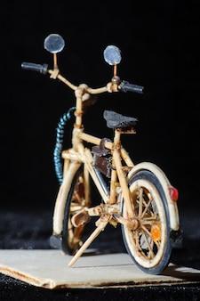 Miniature handicraft detail shot of wooden bicycle