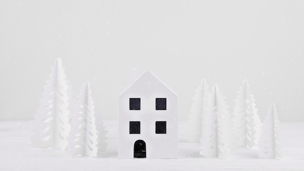 Miniature house with paper trees