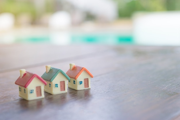Miniature house on wooden background.image for property real estate.