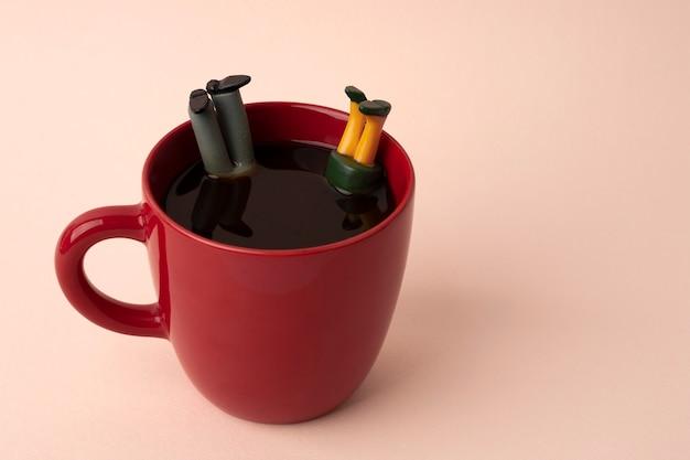 Miniature man and woman falling in coffee