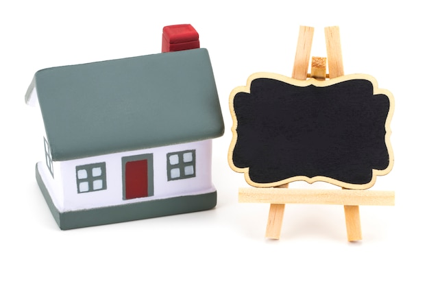 Miniature model of house real estate for rent label on white