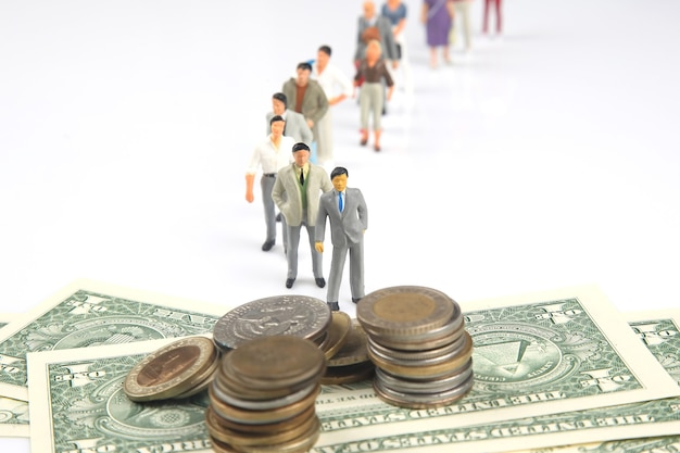 Miniature people are queuing up to get paid