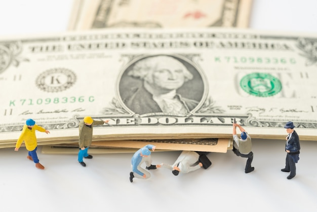 Miniature people are trying to help people who were crushed by dollar money