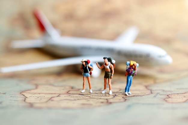 Miniature people, backpacker with airplane.