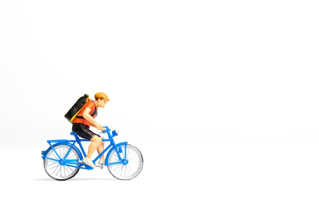 Miniature people bicycle courier with parcel box on the back  isolated on white background ,express delivery service concept