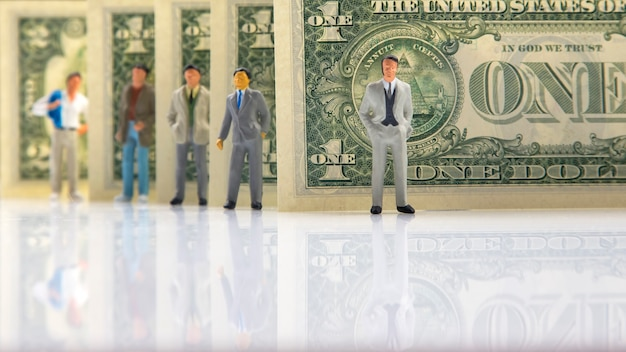Miniature people. business men stand near dollar money. business entrepreneur concept