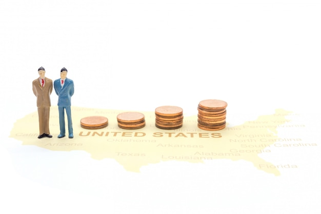 Miniature people, businessman standing on map american