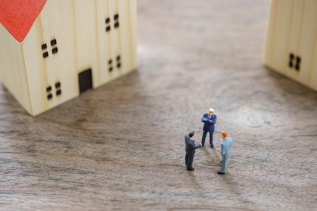 Miniature people businessmen standing to check the quality in the home