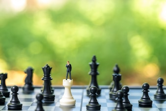 Miniature people businessmen standing Chess Analysis Communicate