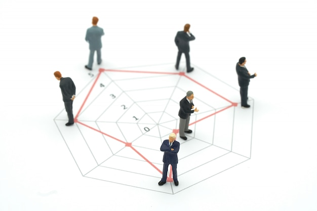 Miniature people businessmen standing on a circle graphs of various skill levels