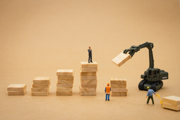 Miniature people  businessmen standing investment analysis or investment.