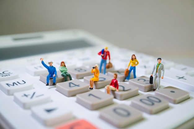 Miniature people on calculator