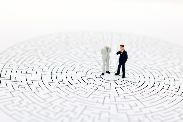 Miniature people in the center of a maze