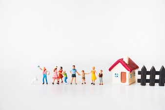 Miniature people, children playing at home using as family and education concept