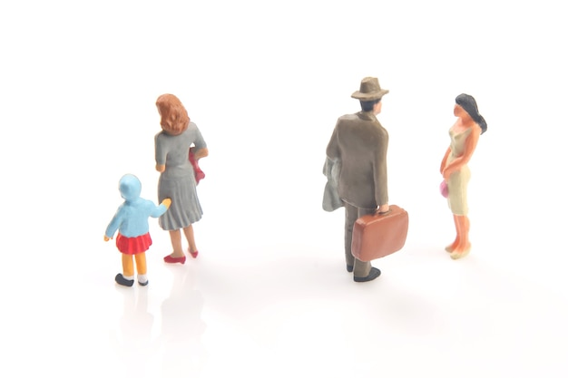 Miniature people. concept of family people in relationships. the problem of fidelity in marriage. raising children in problematic relationships in the family.