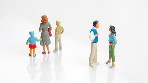 Miniature people. concept of family people in relationships on a white background. the problem of fidelity in marriage. raising children in problematic relationships in the family
