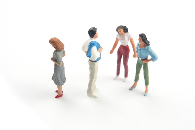 Miniature people. concept of family people in relationships on a white background. the problem of fidelity in marriage.