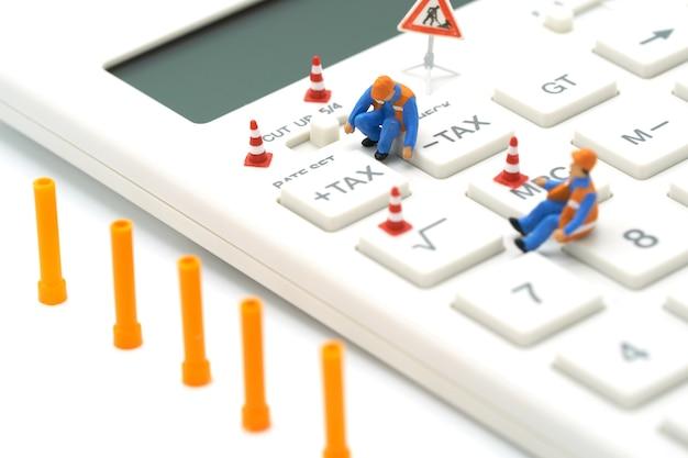 Miniature people construction worker keypad tax button