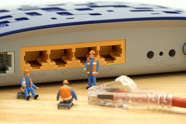 Miniature people construction worker lan connection or connect