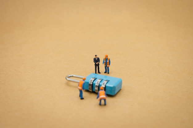 Miniature people construction worker security key repair and the treatment