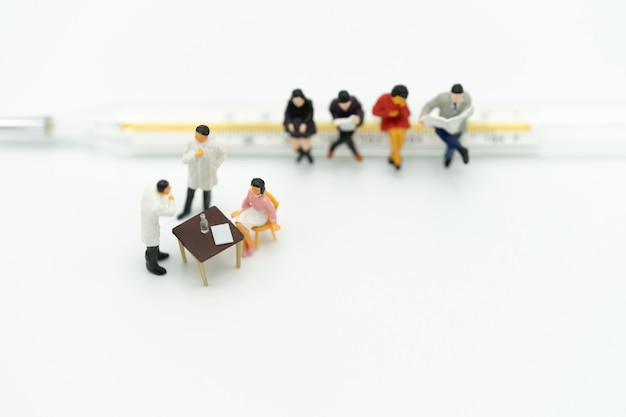 Miniature people consult a doctor to ask for health problems. annual health check