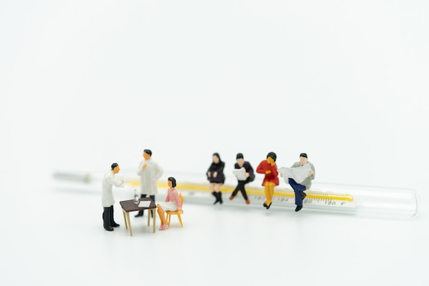 Miniature people consult a doctor to ask for health problems