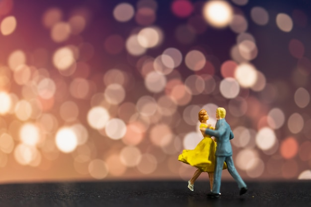 Miniature people , couple dancing with bokeh background
