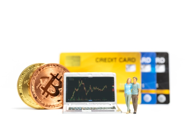 Miniature people , couple looking at crypto currency chart on laptop background , cryptocurrency and financial concept