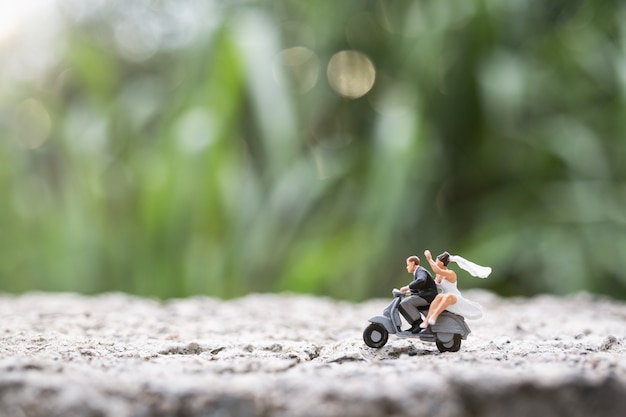 Miniature people:  couple riding the motorcycle