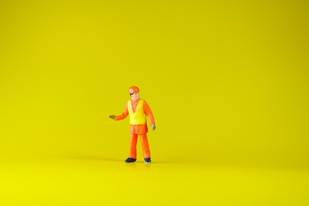Miniature people, engineer standing alone using as industry and business concept
