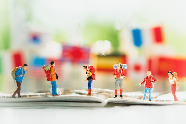 Miniature people, group of traveler on journey, using as background traveling or business concept
