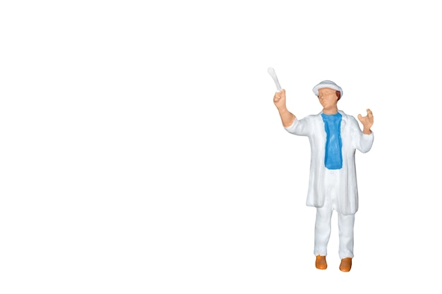 Miniature people : painter holding a brush isolated on white background