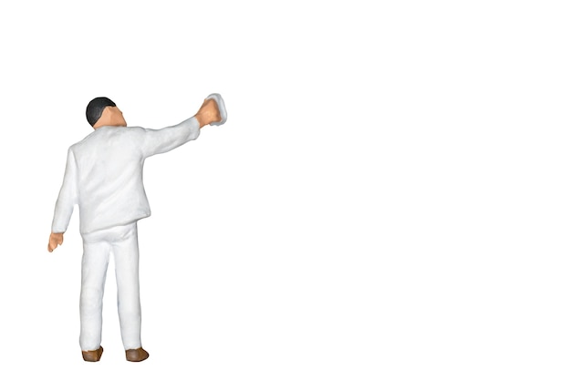 Miniature people : painter holding a brush isolated on white and clipping path