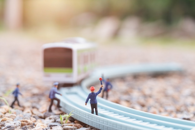 Miniature people: railway staff are working at railway