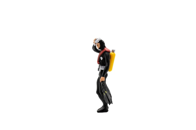Miniature people. scuba diver isolated on white
