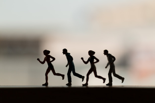 Miniature people: silhouette of a runner