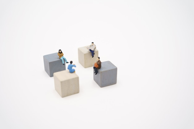 Miniature people stay apart to reduce covid 19 virus